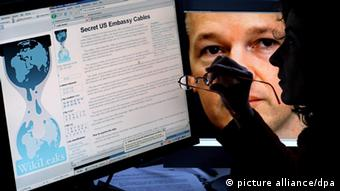 Photo of the WikiLeaks website and its founder Julian Assange