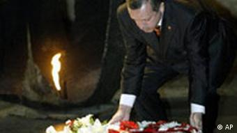 Turkish Prime Minister Recep Tayyip Erdogan lays a wreath at the Hall of Remembrance at Yad Vashem Holocaust Memorial in Jerusalem Sunday May 1, 2005. Erdogan arrived in Israel on Sunday for a visit seeking to mend relations with the Jewish state and join in a new wave of Middle East peace efforts.(AP Photo/Oded Balilty)