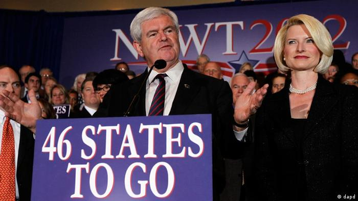 Republican presidential candidate former House Speaker Newt Gingrich accompanied by his wife Callista