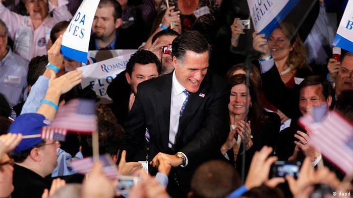 Republican presidential candidate, former Massachusetts Gov. Mitt Romney, greets supporters at his Florida primary primary night rally in Tampa, Fla., Tuesday, Jan. 31, 2012. (AP Photo/Gerald Herbert)