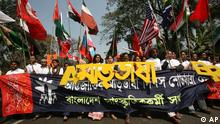 Bangladeshi cultural activists carry flags of different countries during an International Mother Language Day rally in Dhaka, Bangladesh, Friday, Feb. 20, 2009. International Mother Language Day is observed in commemoration of the movement where a number of students died in 1952, defending the recognition of Bangla as a state language of the former East Pakistan, now Bangladesh. The banner reads 'International Mother Language Day'. (AP Photo/Pavel Rahman)