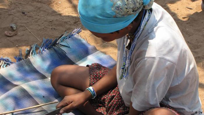A young Tsumkwe resident at work on a bracelet