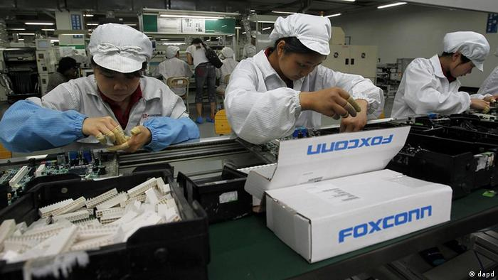Production line at Foxconn complex in Shenzhen, China (AP Photo/Kin Cheung)