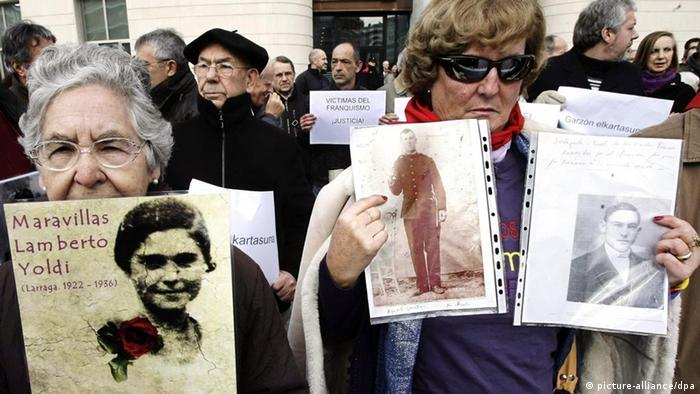 People hold pictures of relatives killed and missing Franco's dictatorship