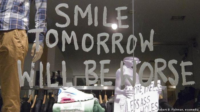 Graffiti on a Portuguese shop window: Smile, tomorrow will be worse.