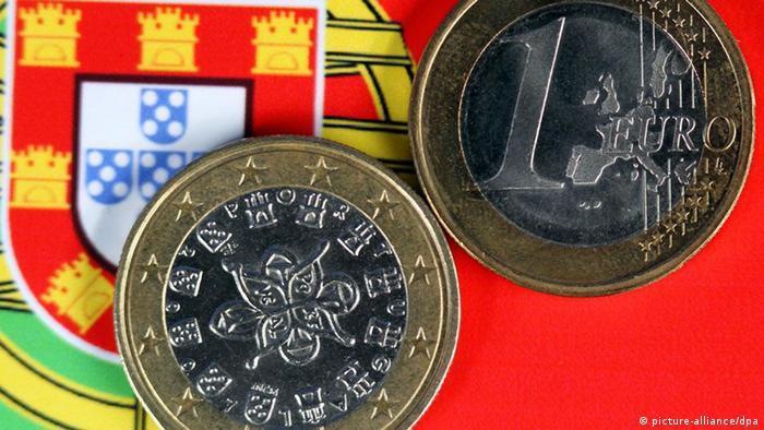 Portuguese euro coins on a Portuguese flag