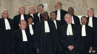 The Judges of the International Tribunal for Rwanda pose after a ceremony to mark the solemn declaration and swearing in for new tribunal, in The Hague, Tuesday, June 27. 1995. Front row, from left: Prosecutor Richard Goldstone, Senegal Laity Kama, Australian Ninian Stephen, dep.prosecutor, Madagascarian Hanove Rakotomanana. Middle row, from left: South African Ms Navanethem Pillay, Bangladesh i Tafazzal Hossain Khan, Tanzanian William H. Sekule, Canadian Jules Deschenes. Back row from left: Chines Haopei Li, Russian Yacov A. Ostrovsky, Italian Antonio Cassese, Egyptian Georges Abi-Saab, Sweden Lennart Aspegren. (AP/PHOTO Boyan Stone)