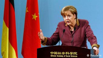 German Chancellor Angela Merkel delivers a speech at the Chinese Academy of Social Sciences in Beijing February 2, 2012. REUTERS/David Gray (CHINA - Tags: POLITICS BUSINESS)