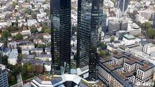 The headquarters of Deutsche Bank, center, is photographed in Frankfurt, Germany, Tuesday, Oct. 25, 2011. Deutsche Bank AG said Tuesday that it made euro 777 million (US dollar 1.1 billion) in net profit, beating analyst estimates, as stronger consumer banking made up for falling profits from trading securities amid market turbulence from Europe's government debt crisis. (ddp images/AP Photo/Michael Probst)