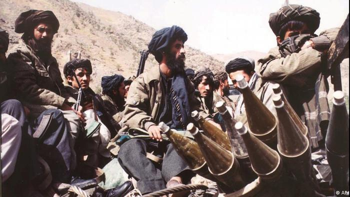 Taliban fighters seen near Kabul Thursday, Oct. 3, 1996. The Taliban, an Islamic fundamentalist army, took over Kabul and drove out forces loyal to President Burhanuddin Rabbani a week ago. Taliban forces now control most of Afghanistan. (AP Photo/Hurriyet) -- TURKEY OUT --