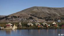 Residents walk at at one of the Uros floating islands on the Titicaca lake in Puno, Peru, Sunday, May 29, 2011. Tourism has diminished in the islands due to the anti-mining strike in Puno that is being held since May 9. The Uros islands are known as floating ones because they are made of totora, a plant that grows on the Titicaca lake, and that is woven to form a floating surface. (ddp images/AP Photo/Juan Karita)