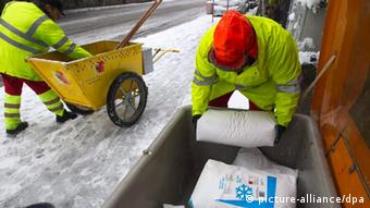 Officals in Geneva use salt to clear ice