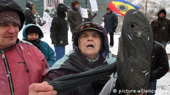 An elderly woman joins protests