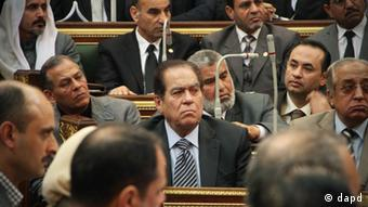 Kamal el-Ganzouri attends an emergency working session in parliament