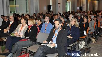 People listening to a speaker at the ifbookthenconference