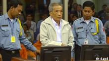 In this photo released by the Extraordinary Chambers in the Courts of Cambodia, former Khmer Rouge S-21 prison commander Kaing Guek Eav, also known as Duch, center, arrives in the courtroom for a session of U.N.-backed tribunal in Phnom Penh, Cambodia, as the court gives verdict on appeal filed by Duch against his conviction Friday, Feb. 3, 2012. Duch was sentenced last July to 35 years in prison for war crimes and crimes against humanity during the killing fields regime of the 1970s. (Foto:Extraordinary Chambers in the Courts of Cambodia, Nhet Sok Heng/AP/dapd) EDITORIAL USE ONLY