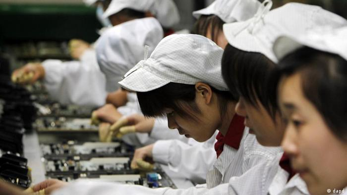 Staff members work on the production line at the Foxconn complex in the southern Chinese city of Shenzhen (Photo: Kin Cheung)