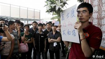 Protestaktion gegen Selbstmorde bei Foxconn. (Foto: ddp images/AP Photo/Kin Cheung)