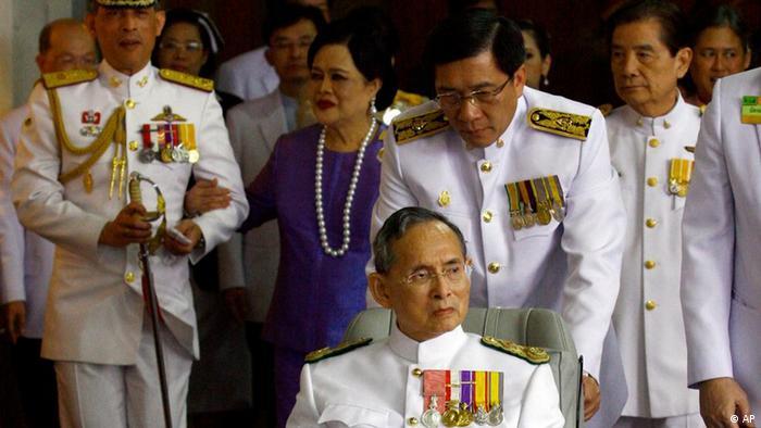 Accompanied by Crown Prince Vajiralongkorn, and Queen Sirikit, accompanying Thailand's King Bhumibol Adulyadej