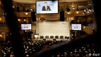 German Foreigns Minister Thomas de Maiziere is seen on huge TV screens as he opens the Conference on Security Policy on, Friday, Feb. 3, 2012 in Munich, Germany. Politicians and military representatives will join for the 48. Munich Security conference from Friday, Feb. 3 until Sunday, Feb. 5, 2012.(Foto:Frank Augstein/AP/dapd)