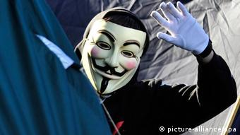A person wearing a Guy Fawkes mask (Photo: Marc Tirl)