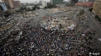 Egyptian protesters attending Friday prayers in Tahrir Square