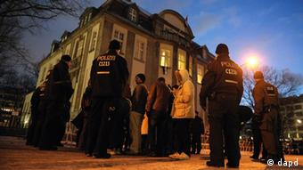Police and protesters outside of Syrian embassy Berlin