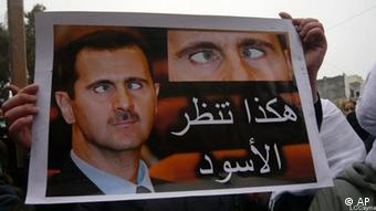 In this picture taken on January 6, 2012 and released by the citizen journalism image provide by the Local Coordination Committees in Syria, anti-Syrian regime protesters, hold a placard against Syrian President Bashar Assad with Arabic words read:The lions look like this, during a demonstration, in Edleb province, Syria. Throughout 40 years of Assad family dictatorship, one thing united Syrians _ the culture of self-censorship, fear and paranoia. But the uprising against President Bashar Assad has unleashed a burst of blunt irreverence and black humor that would have been unthinkable before, when any satire had to be indirect or hidden. (Foto:Local Coordination Committees in Syria/AP/dapd) EDITORIAL USE ONLY, NO SALES, THE ASSOCIATED PRESS IS UNABLE TO INDEPENDENTLY VERIFY THE AUTHENTICITY, CONTENT, LOCATION OR DATE OF THIS HANDOUT PHOTO