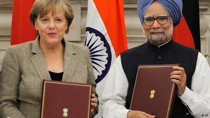 Indian Prime Minister Manmohan Singh, right, and German Chancellor Angela Merkel hold documents before exchanging them during a signing of agreement ceremony in New Delhi, India, Tuesday, May 31, 2011. Merkel is in India for talks with the country's prime minister on trade and defense. (AP Photo/Saurabh Das)