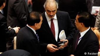 Syria's Ambassador to the United Nations (U.N.) Bashar Jaafari (C) speaks with China's Ambassador Li Baodong (L) as they arrive at the U.N. Security Council to discuss a European-Arab draft resolution endorsing an Arab League plan calling for Syria's President Bashar al-Assad to give up power in New York February 4, 2012. The Homs attack made Friday the bloodiest day of an 11-month uprising and it gave new urgency to a push by the Arab League, the United States and Europe for a U.N. resolution calling for Assad to cede power. The Security Council had scheduled an open meeting for Saturday to vote on the draft. But Russia asked that the 15-nation body not immediately do so and instead hold consultations. REUTERS/Allison Joyce (UNITED STATES - Tags: POLITICS)
