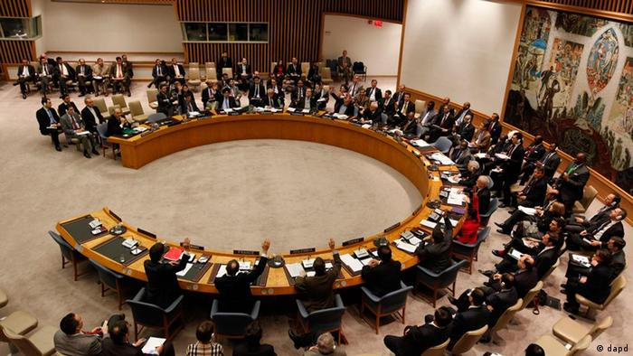 Member states vote on a draft resolution backing an Arab League call for Syrian President Bashar Assad to step down, which was later vetoed by Russia and China, during a meeting of the United Nations Security Council at UN headquarters Saturday, Feb. 4, 2012. The unusual weekend session comes as Syrian forces pummel the city of Homs with mortars and artillery in what activists are calling one of the bloodiest episodes of the uprising. (AP Photo/Jason DeCrow)