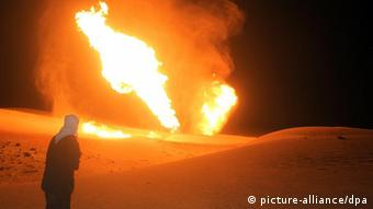 A night scene shows flames rising from a gas pipeline in Egypt