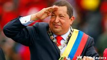 Venezuelan President Hugo Chavez arrives at a military parade to commemorate the 20th anniversary of his failed coup attempt in Caracas February 4, 2012. REUTERS/Jorge Silva (VENEZUELA - Tags: POLITICS)