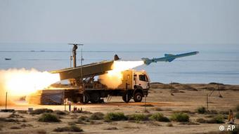 An Iranian missile is launched at the shore of sea of Oman