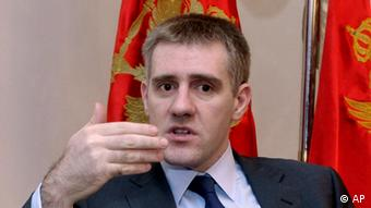 In this photo taken Nov. 23, 2011, Montenegro Prime Minister Igor Luksic speaks and gestures during an interview with The Associated Press, in Podgorica, Montenegro. Luksic said Monday his government won't abandon the euro as its currency, despite concerns that the eurozone crisis could damage the small Balkan economy. Montenegro adopted the euro when it was launched in 2002, circumventing the rigorous economic criteria imposed on nations already in the bloc but not yet ready to adopt its common currency.(AP Photo/Risto Bozovic)Image 1 of 20
