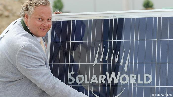 Solarworld's CEO Frank Asbeck presenting a solar panel