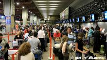 Passengers queue as they wait for flights at Guarulhos International Airport (Cumbica), near Sao Paulo, Brazil, on August 2, 2010. About 9% of Brazil's Gol airline domestic flights has been canceled today, and over 47% were delayed, according to the Brazilian Airport Infrastructure Company (Infraero, in Portuguese). The problem occured due to the intense air traffic on Friday, in which some crews reached the limit of working hours allowed and therefore were unable to fly. Photo: HELVIO ROMERO/AGÊNCIA ESTADO/AE