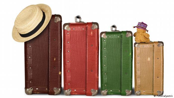 Symbolbild Reisen Koffer Familie Urlaub
