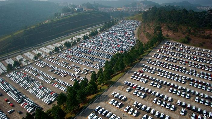 Thousands of brand new cars at the parking lot of the Volkswagen assembly plant in Sao Bernanrdo do Campo, Brazil on Wednesday, June 18, 2003. Brazilian industrial production fell 4.2% in April from a year ago, ending 10 straight months of year-on-year growth as the economy heads toward a recession following a recent series of central bank interest rate hikes. Investors were anticipating the results of the central bank's interest rate meeting this Wednesday. The market expects the main interest rate, currently at 26.5 percent, to be cut half a percentage point on recent reports of easing inflation and shrinking output.(AP Photo/Dario Lopez-Mills)