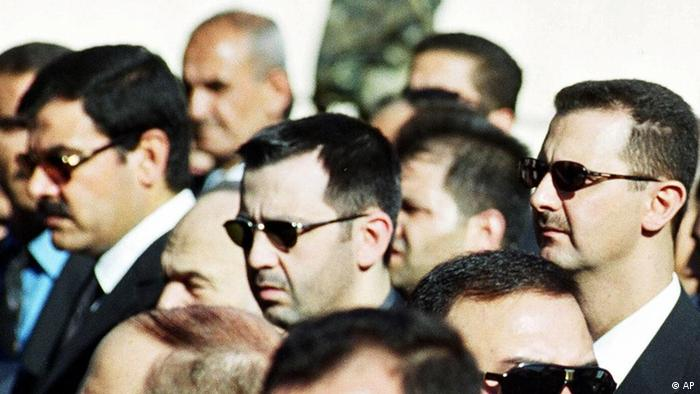 Syrian President Bashar al-Assad, right, his brother Maher, centre, and brother-in-law Major General Assef Shawkat, left, stand during the funeral of late president Hafez al-Assad in Damascus on June 13, 2000. Syria is considering a U.N. request to interview six top officials about the slaying of a former Lebanese leader, a Foreign Ministry official said Monday, while declining to disclose the identities of the people that the U.N. investigators want to question except that they want to see Gen. Assef Shawkat, the brother-in-law of Syrian President Assad, among others. (AP Photo)