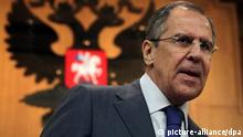 Russian Foreign Minister Sergei Lavrov is seen with the Russian State Emblem in the background as he arrives at his annual news conference in Moscow, Russia 18 January 2012. Reports state that Lavrov warned that an attack on Iran would cause a catastrophe and said US and European Union sanctions against Tehran were aimed at formenting popular discontent by 'strangling' the economy. EPA/MAXIM SHIPENKOV pixel