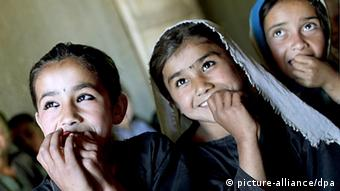 Young Afghan girls smiling