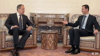 Syrian President Bashar Assad meets with Russian Foreign Minister Sergey Lavrov