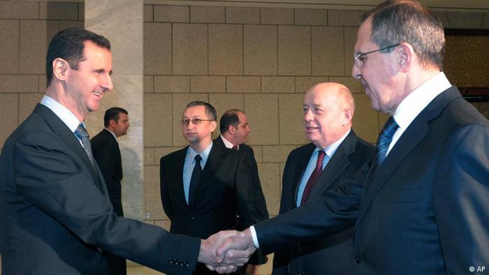 Syrian President Bashar Assad with Russian Foreign Minister Sergey Lavrov