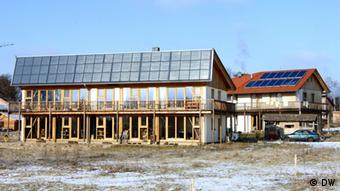 Eco-friendy homes in wood with solar panels on the roof. (Photo: Karin Jäger)