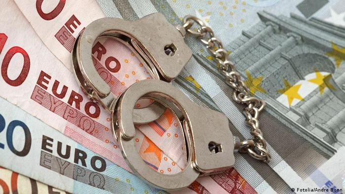 Handcuffs on euro banknotes