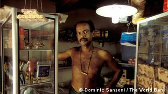 Solar energy is used to light village shop, Sri Lanka