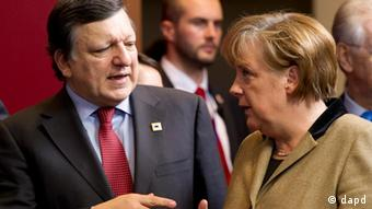 Angela Merkel and Jose Manuel Barroso talk at an EU summit in Brussels