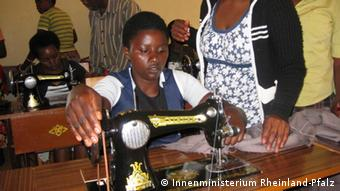 A young woman sews at a vocational school in Rwanda