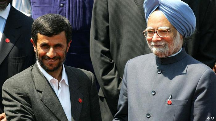 Iranian President Mahmoud Ahmadinejad, left, shakes hands with Indian Prime Minister Manmohan Singh in Havana, Cuba